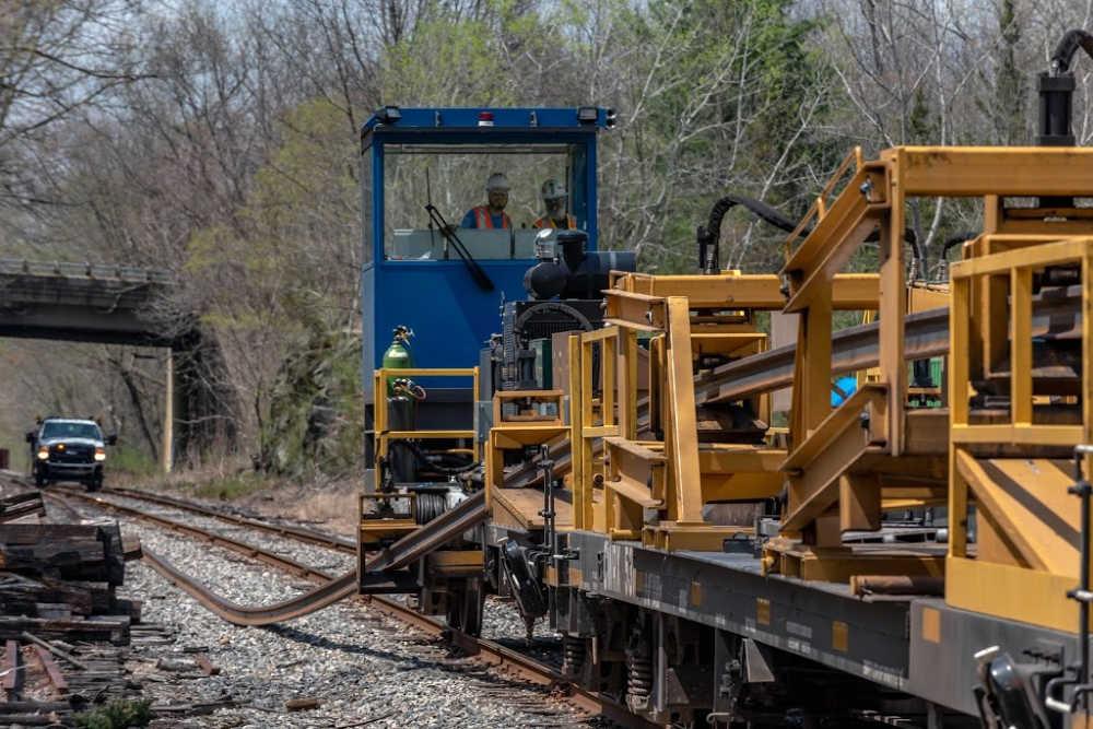 Rail trains that transport continuous welded rail
